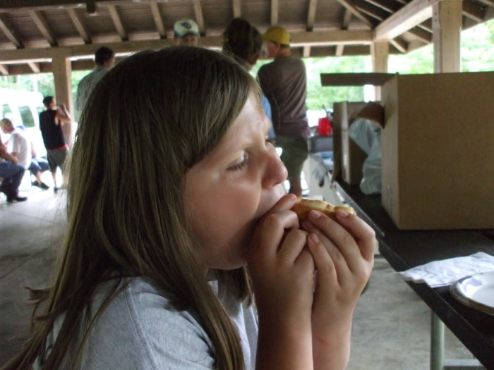 Kayla is really enjoying that free hot dog!