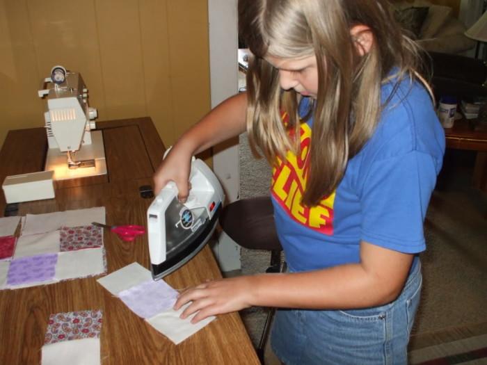 Kayla ironing her row