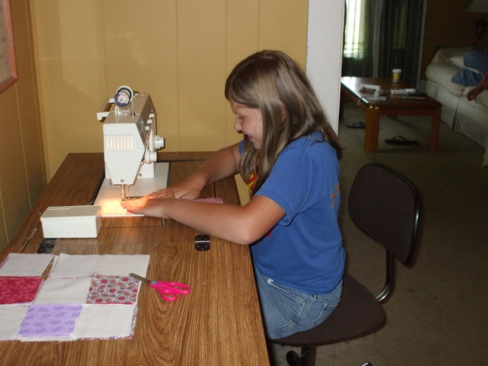 Kayla sewing her project together