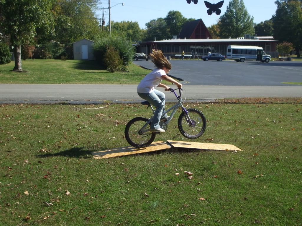 how to build a bike ramp with your kids jen around the world. Black Bedroom Furniture Sets. Home Design Ideas