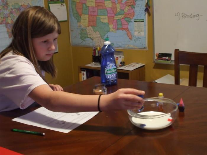 Kayla adding food coloring