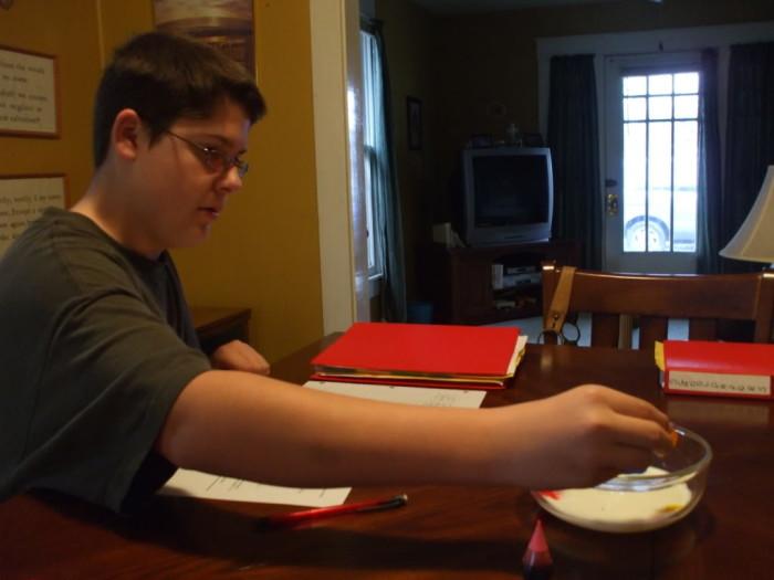 Robert adding food coloring