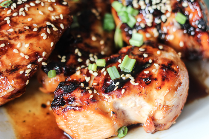Grilled Teriyaki Chicken topped with green onions and sesame seeds