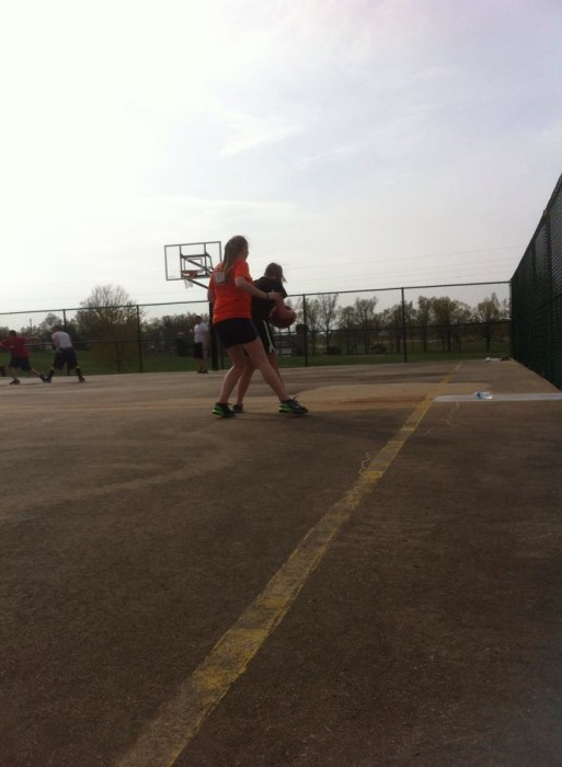Kayla and Maddie playing basketball