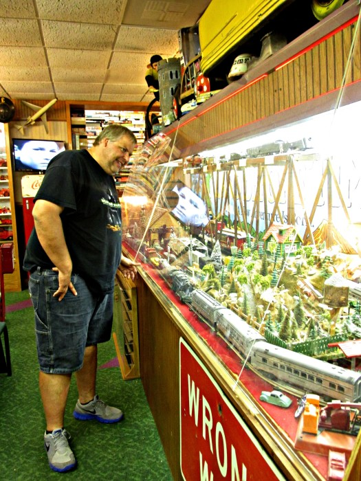 Stephen with his toy train set at the World's Largest Toy Museum
