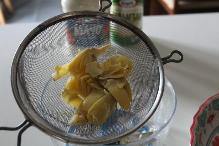 Drain your artichoke hearts for Hot Artichoke Dip