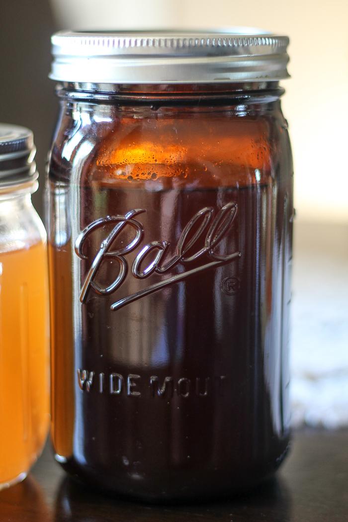 Crockpot apple cider in Ball Amber Canning Jars